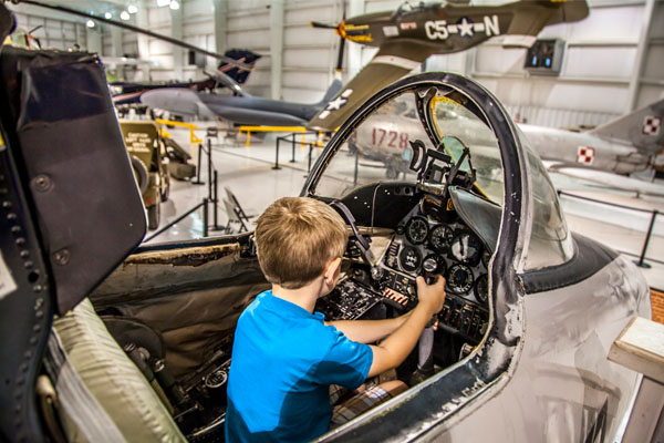 A boy playing at Tennessee Museum of Aviation